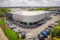 Caddick's North East Team celebrates completion on JCT600 Porsche Showroom